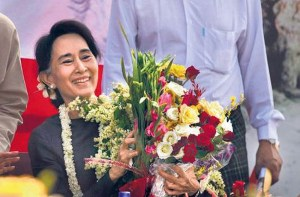 Suu Kyi with flowers