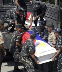 Becoming an all too familiar site - Here Philiipine forces carry the flag-draped coffins of soldiers killed in clashes with Abu Sayyaf militants in Basilan province, on August 14 2009, as they are brought to a gymnasium in Zamboanga City in the southern Philippines