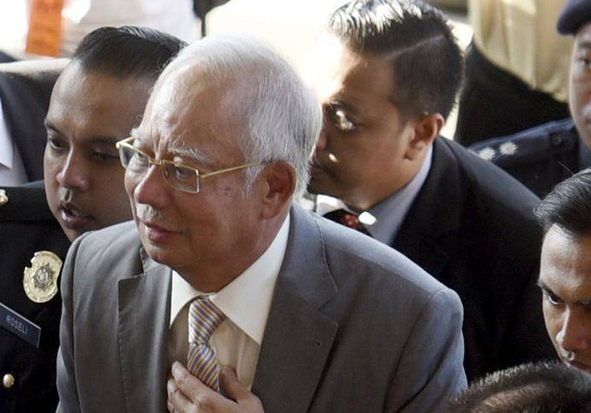 Malaysia's ex-PM, former treasury official charged with misuse of $1.6 billion