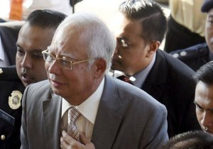 Malaysia's ex-PM, former treasury official charged with misuse of .6 billion