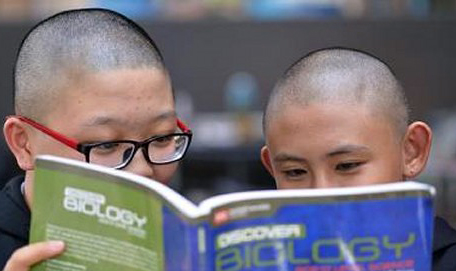 Bald Singapore students told to wear wigs