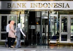 Women walk toward the entrance of Indonesia's central bank building in Jakarta