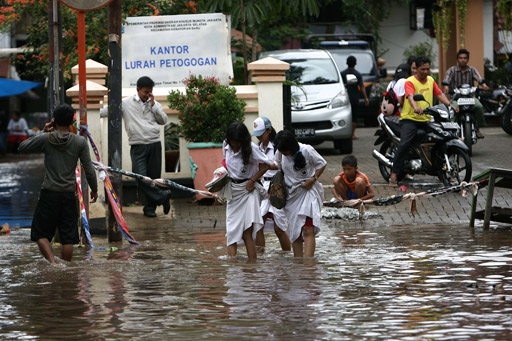 Jakarta residents up to the neck in water