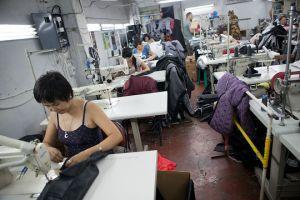 Seamstresses at work inside Vladimir Foton's workshop. Bishkek. David Trilling