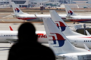 Malaysia Airlines planes sit on the tarmac at the Kuala Lumpur International Airport