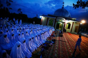 Muslim worshippers gather for an evening collective prayer and zikr outside a mosque in Banda Aceh
