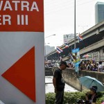 Thai protesters target Shinawatra firms, shares drop
