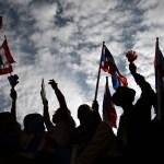 Bangkok protesters cripple key ministries