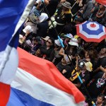 Security stepped up in Bangkok as protests resume
