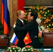 Russian President Putin embraces Vietnamese President Truong after a co-operation signing ceremony between Russia and Vietnam at the Presidential Palace in Hanoi