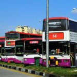 Singapore opens public bus system to private investors