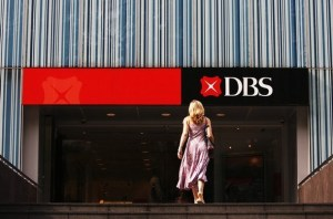 A customer walks towards a branch of the DBS bank in Singapore
