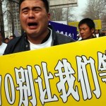 MH370 crash announcement followed by protests