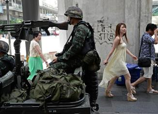 Martial law in Thailand hurts currency, stocks, tourism