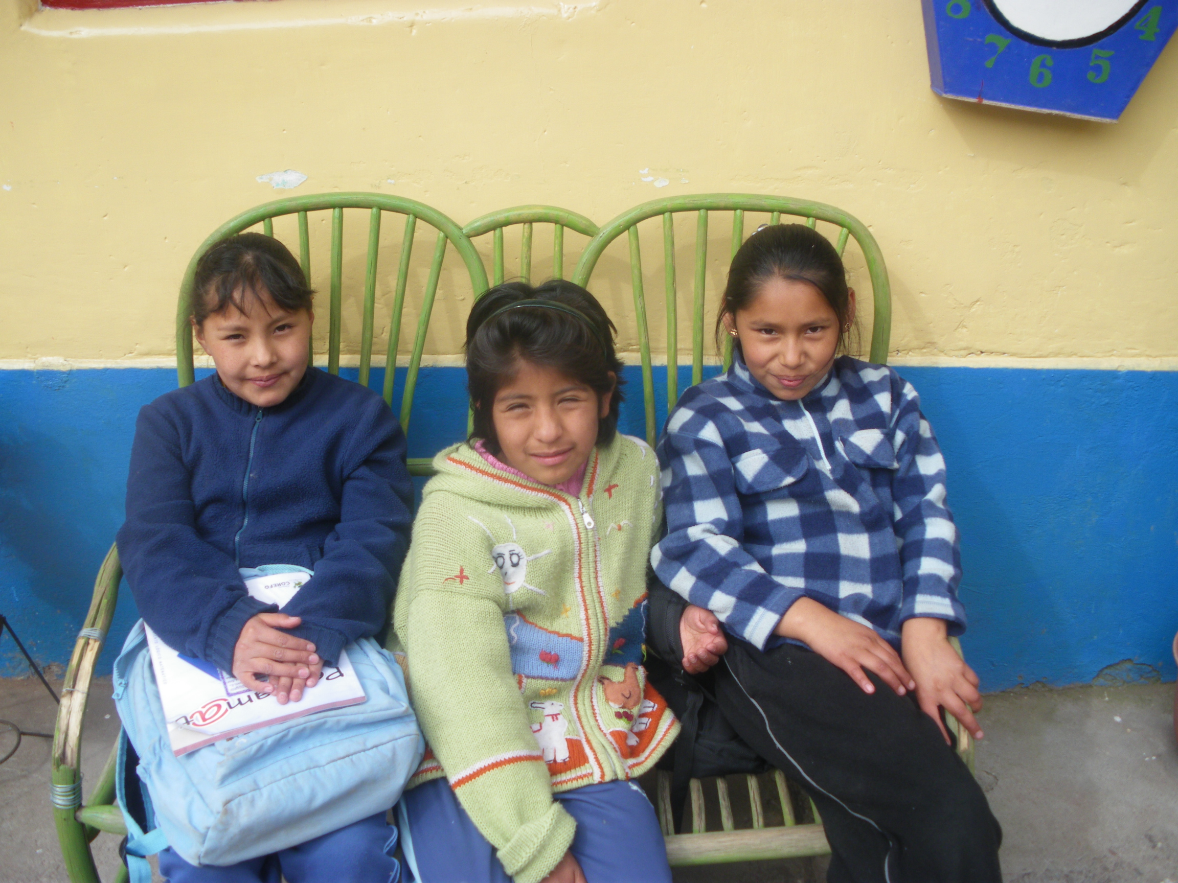 Tres hijas waiting in the courtyard for school to begin.