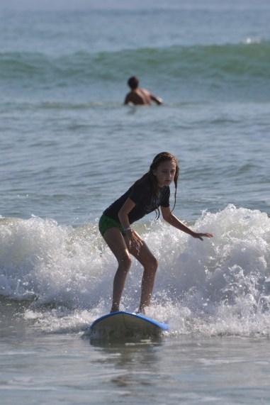 Melanie surfing despite pain