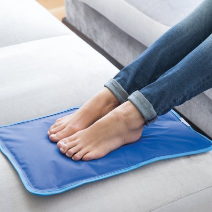 A photo of a woman's feet on the blue JML Chillmax pad.