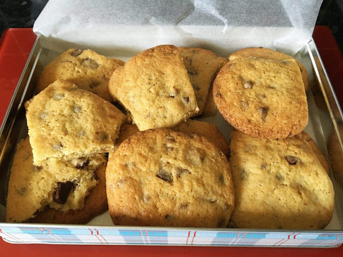 A photo of the cookies in a tin, ready to store for eating, though they didn't last long before they'd been eaten!