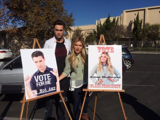 STANDOFF#22 - Ryan McCartan and Olivia Holt - Farrell (Ryan McCartan) and Amy (Olivia Holt) pose with their Class President posters.