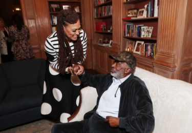"Ava DuVernay and Clarence Avant seen at Netflix's original documentary ""13TH"" reception hosted by Netflix Chief Content Officer Ted Sarandos and Ambassador Nicole Avant with a special conversation moderated by Oprah Winfrey with director Ava DuVernay and Van Jones] on Sunday, January 15, 2017, in Los Angeles, CA. (Photo by Eric Charbonneau/Invision for Netflix/AP Images)"