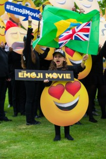 LONDON, ENGLAND - July 17, 2017: Fans getting ready at at St. Thomas Hospital Garden to set the Guinness World Record for the largest gathering of people dressed as emoji faces in celebration of World Emoji Day and Columbia Pictures' THE EMOJI MOVIE.