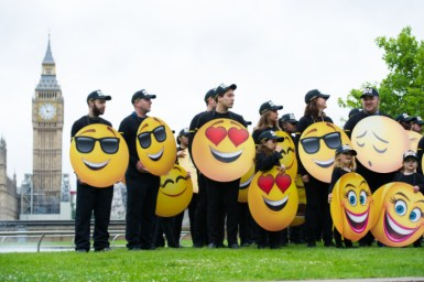 LONDON, ENGLAND - July 17, 2017: Fans in at St. Thomas Hospital Garden getting ready to set the Guinness World Record for the largest gathering of people dressed as emoji faces in celebration of World Emoji Day and Columbia Pictures' THE EMOJI MOVIE.