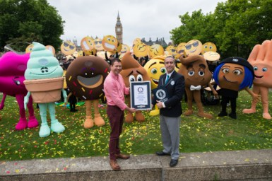 LONDON, ENGLAND - July 17, 2017: Vyv Evans (UK'S leading Emoji expert) and Jack Brockbank (Guinness World Record official Adjudicator) with Emoji at St. Thomas Hospital Garden set the Guinness World Record with 537 people around the world for the largest gathering of people dressed as emoji faces in celebration of World Emoji Day and Columbia Pictures' THE EMOJI MOVIE.