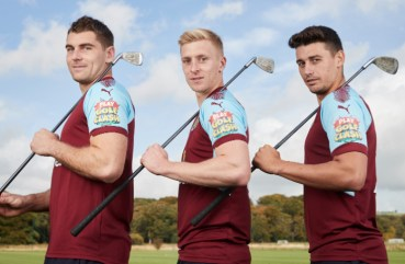 Burnley FC footballers L-R Sam Vokes, Ben Mee and Matt owton wearing the new Playdemic sponsored shirts