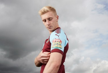 Burnley FC footballer Ben Mee wearing the new Playdemic sponsored shirts