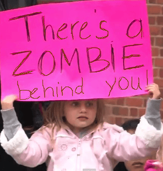 marathon-sign-zombie-behind-you-