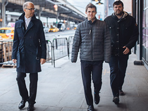 Magnus Carlsen with his father and his second P.H.Nielsen during his match with S. Karjakin.