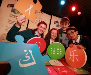 Students with puzzle pieces at national final of All Ireland Linguistics Olympiad