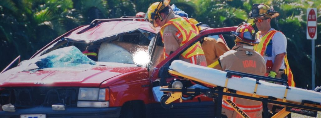 Firefighters assisting victims of a car crash