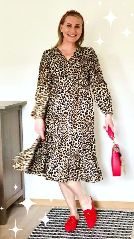 Wearing leopard print dress with red accessories
