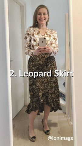 Wearing a printed shirt with a leopard skirt