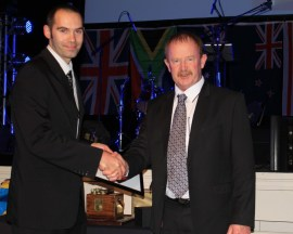 Rocktec's Jason Tapper present George Kelcher with the 2013 Award