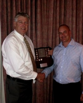 Murray Harvey (left) receives the Paykel Shield from Mike Rawson of Blackwood / Paykel.