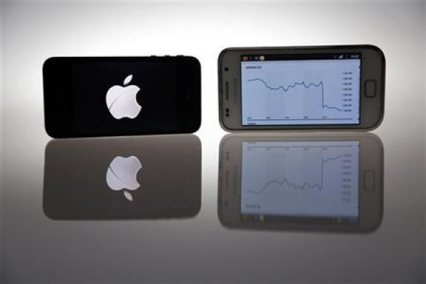 An Apple IPhone 4s and Samsung Galaxy S are seen in this illustration photo