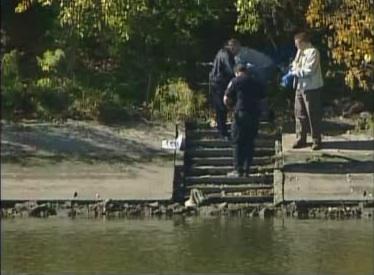 Officials retrieve body from river.