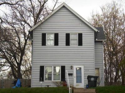 The 1512 Belle Avenue home where Mark and John Green were killed. (Courtesy Scott County Assessor's Office)