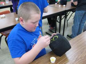 North Winn 5th grader Robert paints numbers on activity dice.
