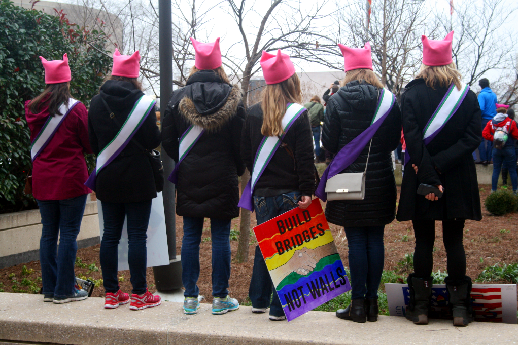 Demonstrators wear pussy hats to protest Trump Saturday near the National Mall during the Women's March on Washington, whose turnout greatly exceeded that of Friday's inauguration. Photo: Gavin Aronsen/Iowa Informer