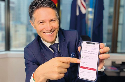 NSW Customer Service Minister Victor Dominello showing the Service NSW QR Check-In app on his phone.