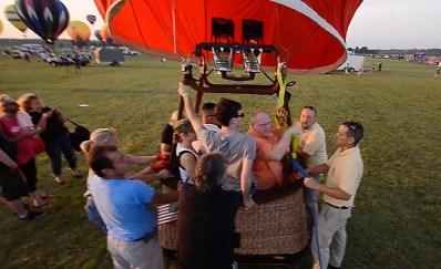 Holding_Balloon_Down