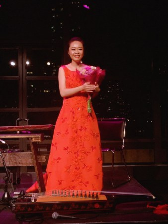 Jiaoyue Lyu with Flowers Following Exquisite Guqin and Zhu Concert at Lincoln Center in New York