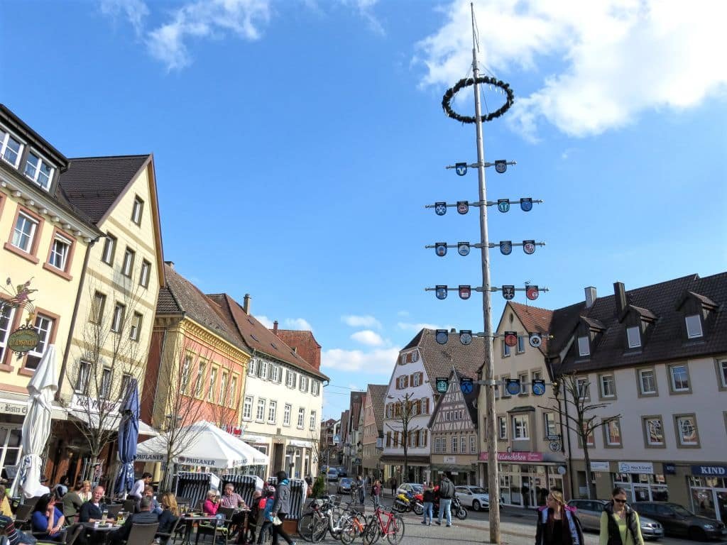 Market Square, Bretten, Germany, pole with coat of arms, cafes