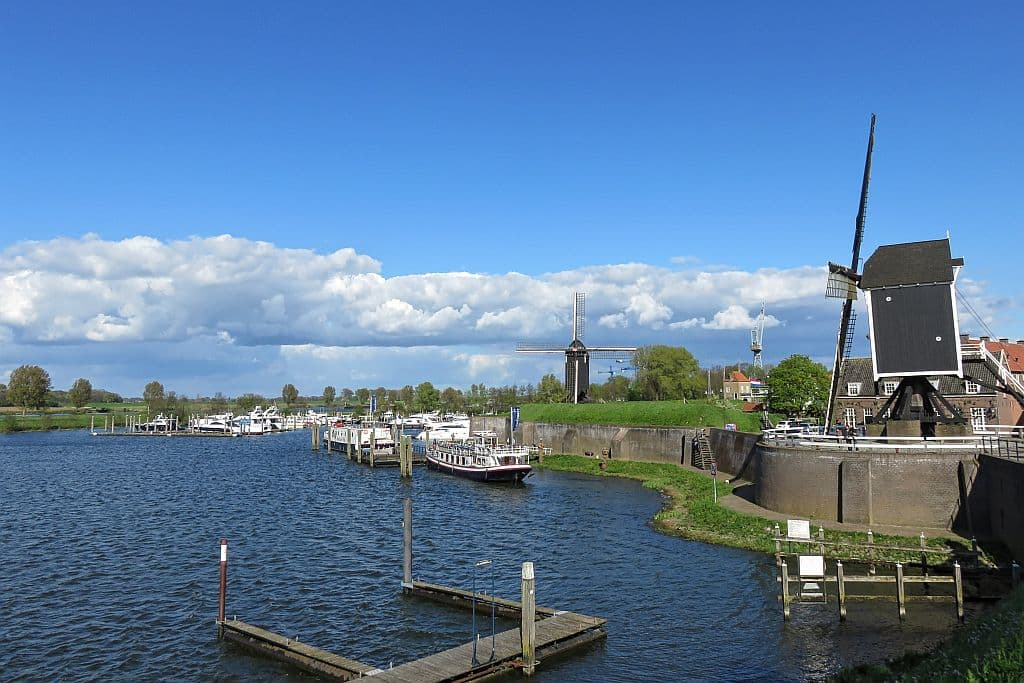 a little harbour with yachts and a windmill, the harbour in Heusden, the Netherlands