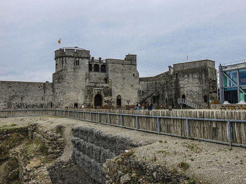 big medieval castle in ruins, St. John's castle in Limerick, Ireland