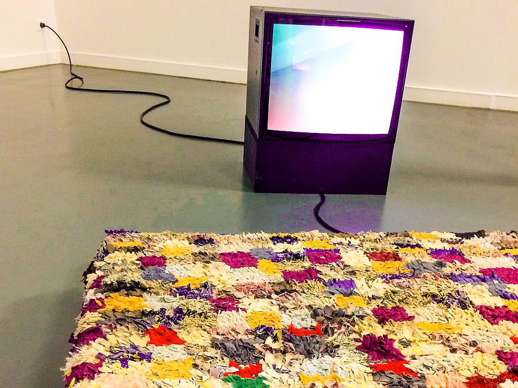 a contemporary art installation with a TV and a patchwork rug, Witte de With Center for Contemporary Art in Rotterdam