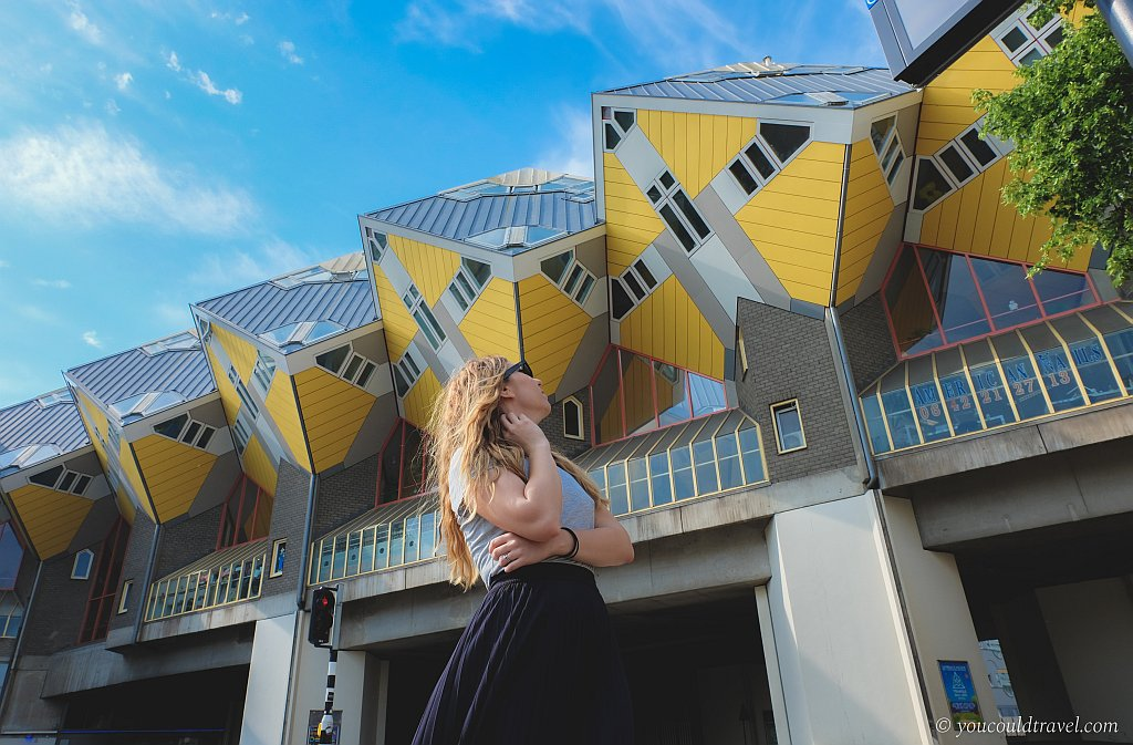 yellow cubes houses reclining towards ground, contemporary architecture in Rotterdam